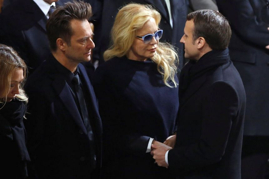 French President Emmanuel Macron (above right) paying his respects to Johnny Hallyday's first wife Sylvia Vartan and son David Hallyday at La Madeleine Church.