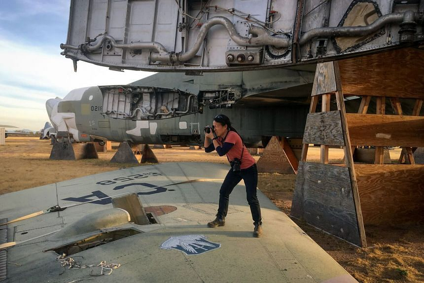 Ms Sim Chi Yin, who was selected to showcase this year's Nobel Peace Prize winner, photographing a decommissioned B-52 bomber at the Davis-Monthan Air Force Base Boneyard in Arizona last month.