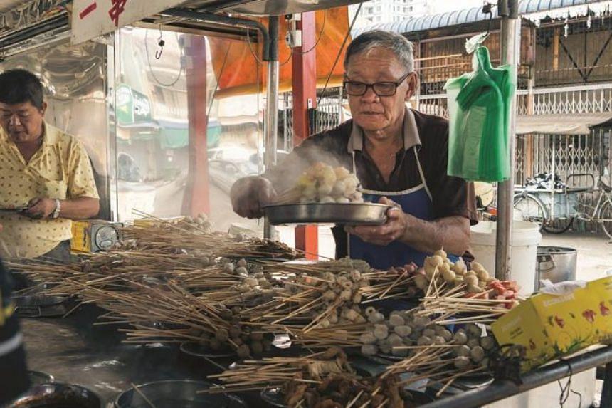 Hawker Lee Koon Huat has been selling his skewered goodies outside a school for 33 years.