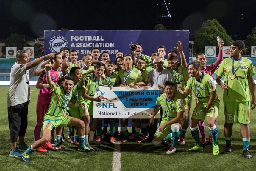 Yishun Sentek Mariners FC players and staff celebrating their NFL Division One 2017 title win after a walkover victory over Katong FC.