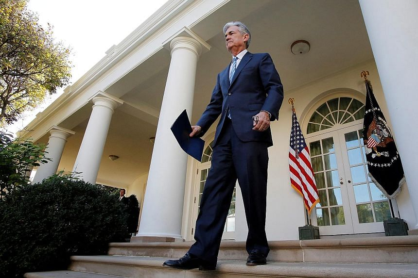 Mr Jerome Powell, seen here at the White House in Washington last month, has been clear he sees little risk of inflation that would prompt the Fed to raise rates faster than expected.