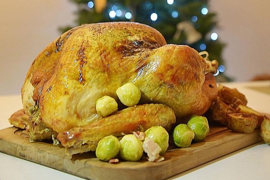 Roast turkey is a whole food that is low in sodium, while honey-glazed ham is highly processed and very high in sodium. Even when served with cranberry sauce and chestnut stuffing, turkey is a better choice.