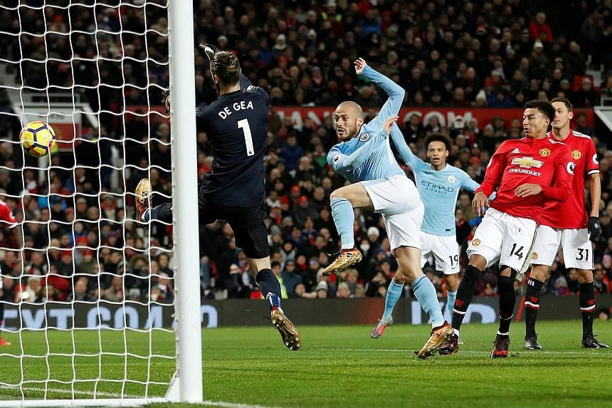 David Silva (second from left) scoring the game's opening goal for Manchester City in the 2-1 victory against Manchester United on Sunday. The home side had only 35 per cent possession and now trail City by 11 points.