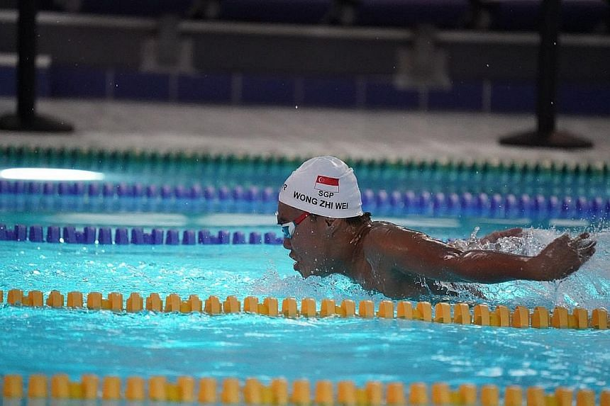Visually impaired swimmer Wong Zhi Wei, 15, (caught in action on a Sony A9) on his way to winning the men's S11-13 100m butterfly at the Asian Youth Para Games in Dubai yesterday. He also won a silver in the 100m backstroke yesterday.