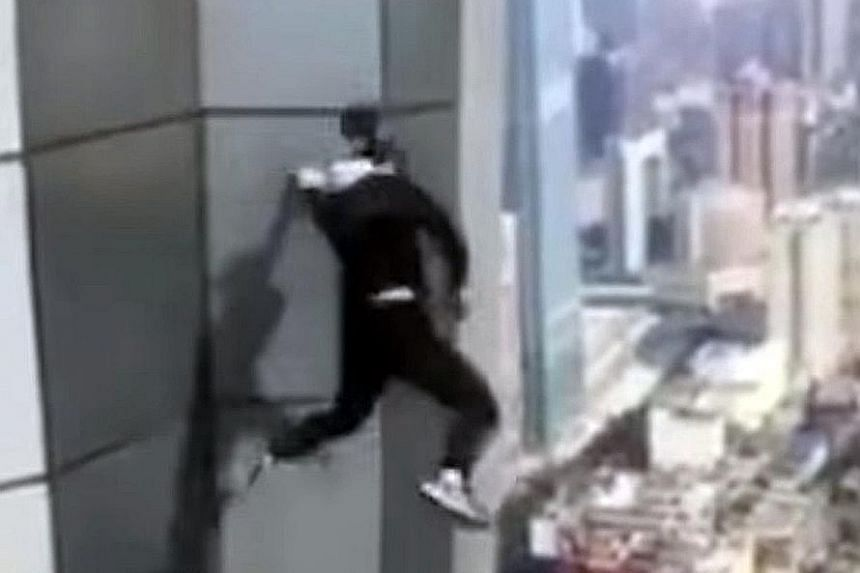 Screen grabs from a video purportedly showing Mr Wu Yongning falling to his death from Huayuan Centre, the tallest building in Changsha.