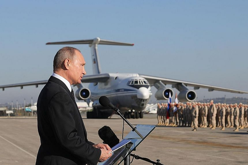 """President Vladimir Putin addressing Russian troops in Syria yesterday, saying Moscow had succeeded in keeping Syria intact as a """"sovereign independent state""""."""