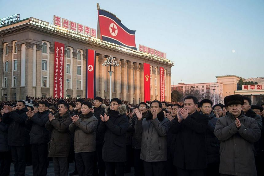 North Koreans attend a mass rally to celebrate the nation's declaration on Nov 29 that it had achieved full nuclear statehood.