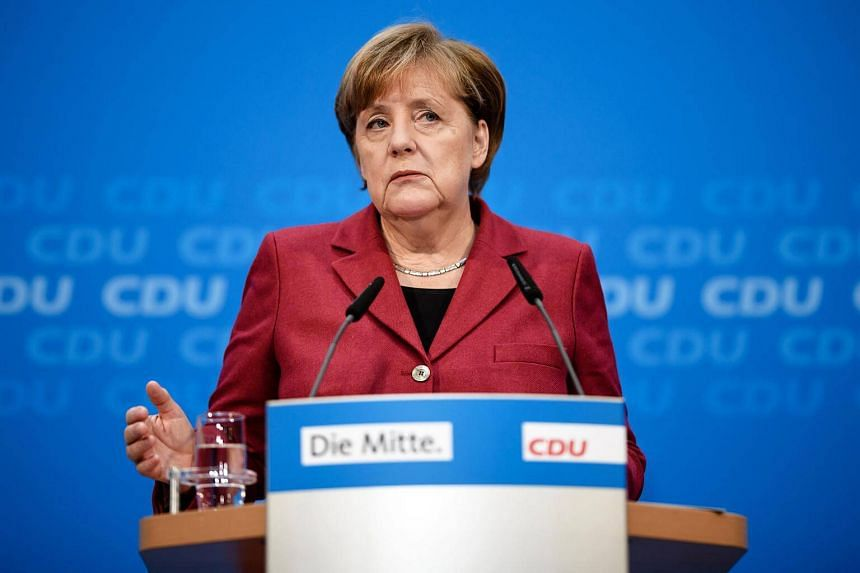German Chancellor and chairwoman of the Christian Democratic Union (CDU), Angela Merkel speaks at a press conference after a party's board meeting at the CDU headquarter in Berlin.