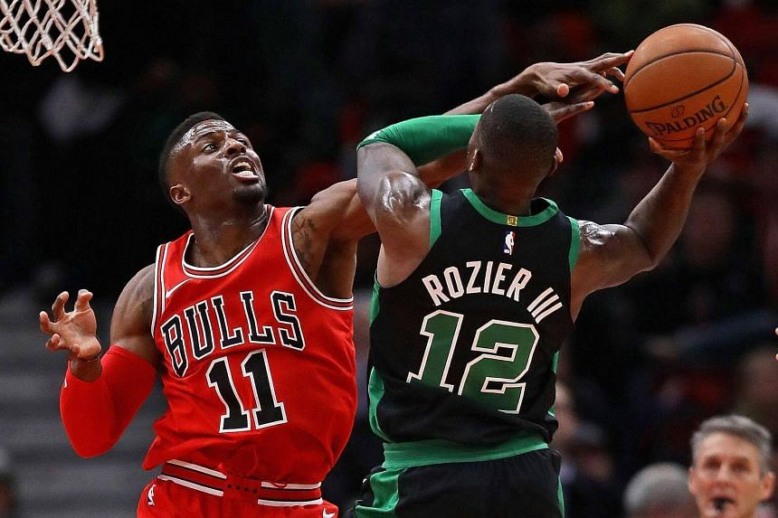 David Nwaba of the Chicago Bulls defends against Terry Rozier of the Boston Celtics at the United Center on Dec 11.