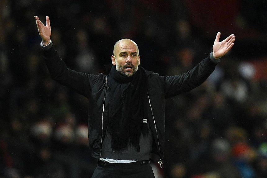 Manchester City manager Pep Guardiola gestures on the touchline during the English Premier League football match between Manchester United and Manchester City at Old Trafford.