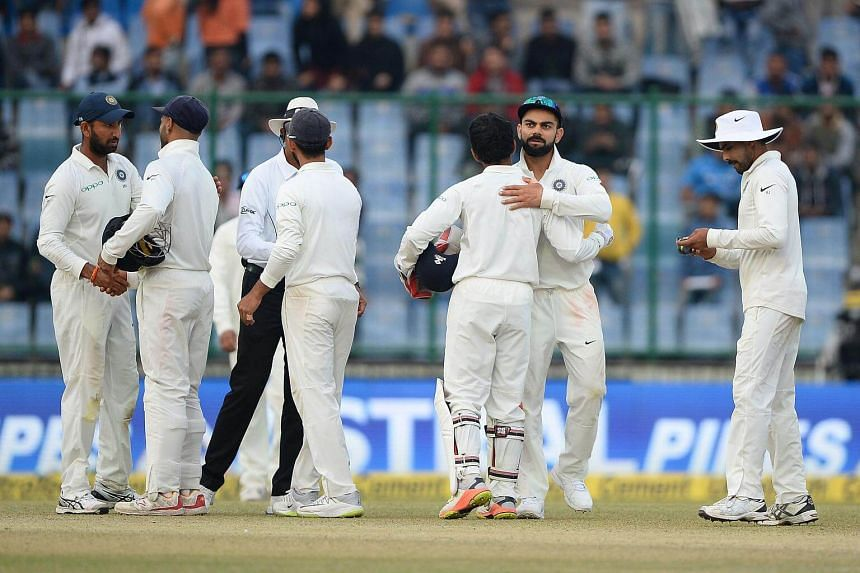 Indian cricket team captain Virat Kohli hugs a teammate at the end of the third test cricket match between India and Sri Lanka.