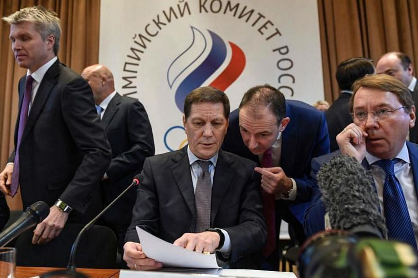 The President of the Russian Olympic Committee, Alexander Zhukov (C) prepares to start a meeting in Moscow on Dec 12, 2017 on deciding how to respond to IOC ban on Russia participating in Winter Games.