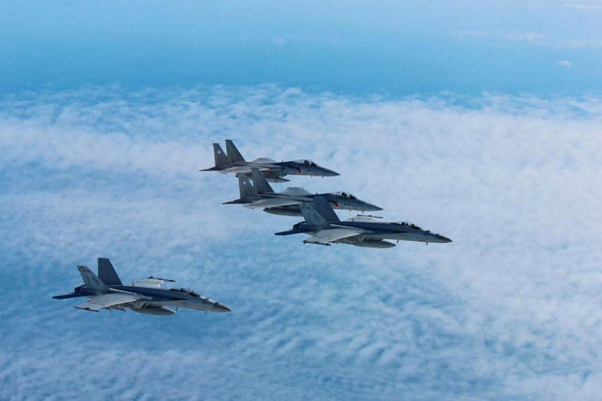 JASDF F-15 fighters held military drills with the US air force off the Korean peninsula on Dec 12, 2017.