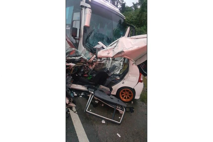 A man, a woman and their three children were pronounced dead at the scene after the car they were travelling in collided with an express bus at Jalan Segamat, Johor on Dec 12, 2017.