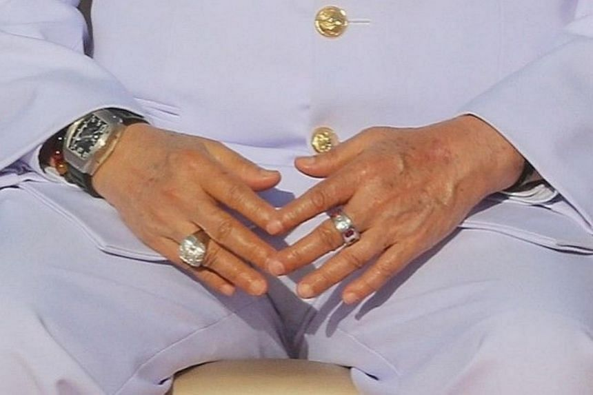 The posh glint of Prawit's wristwatch and diamond ring couldn't fail to catch the public's eye in photos of the newly reshuffled Cabinet last week.
