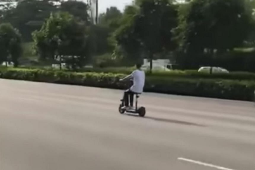 A man riding a personal mobility device in the second lane of the Pan-Island Expressway on Nov 26, 2017.