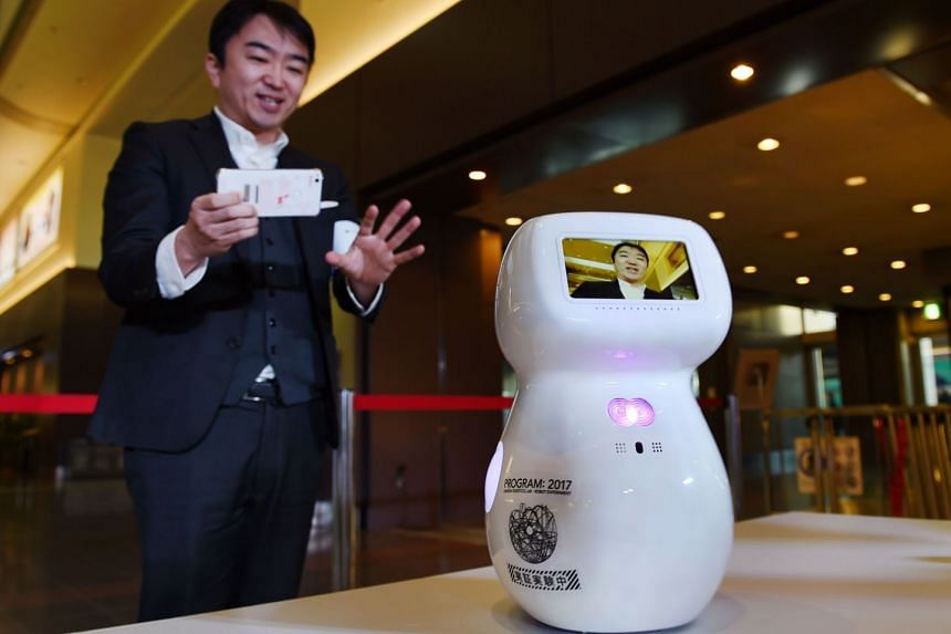 Cinnamon, a communications robot produced by Donut Robotics, which can converse with visitors and give directions.
