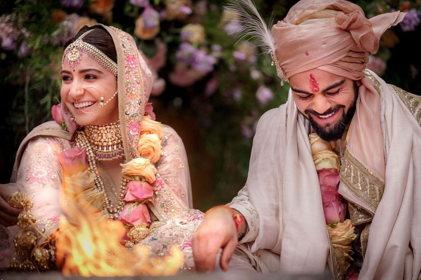 This handout picture released by Yash Raj Films shows Indian cricketer Virat Kohli and Bollywood actress Anushka Sharma at their wedding ceremony in Buoncovento near Siena on Dec 11, 2017.