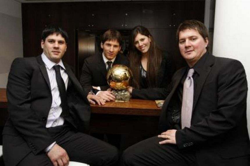 Barcelona star Lionel Messi's family - (from left) brother Matias, Lionel, sister Maria Sol and brother Rodrigo with the Ballon d'Or trophy.