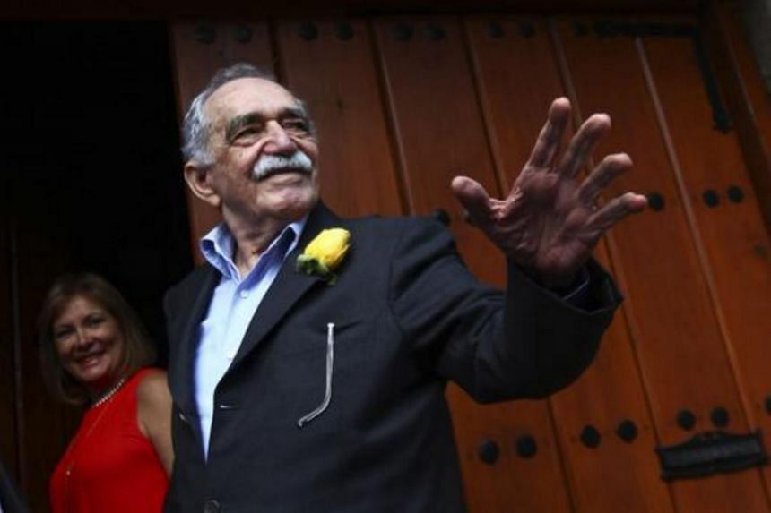 Colombian Nobel Prize laureate Gabriel Garcia Marquez greets journalists and neighbours on his birthday outside his house in Mexico City in 2014.