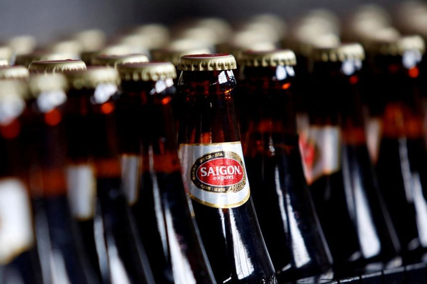 Bottles of Saigon beer move along a production line at a factory in Hanoi, Vietnam.