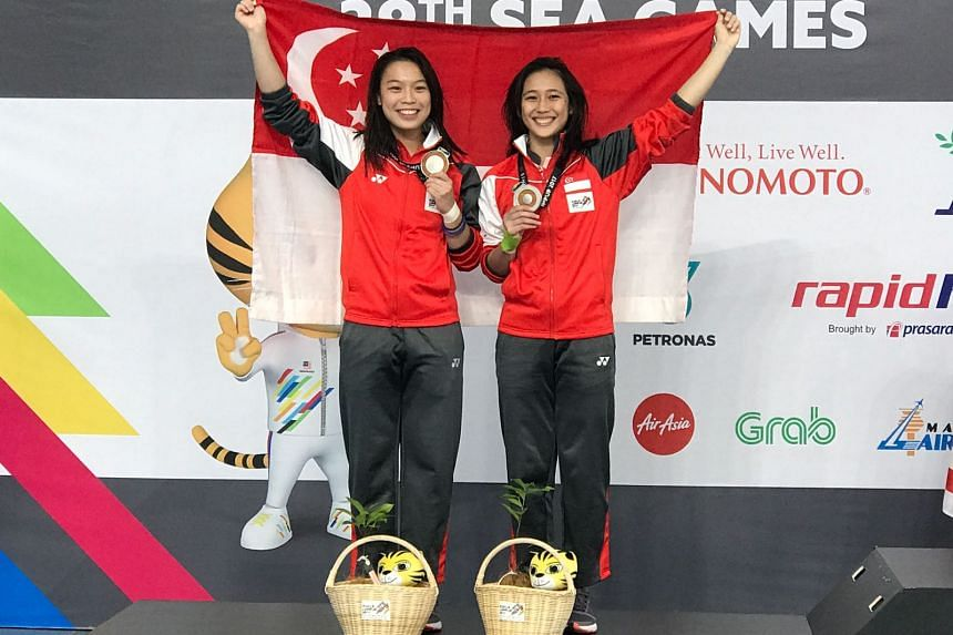 Singapore's 3m springboard synchronised duo of Ashlee Tan (left) and Fong Kay Yian have been awarded the SEA Games gold after Malaysian gold-winning diver Wendy Ng Yan Yee was disqualified for failing a dope test.