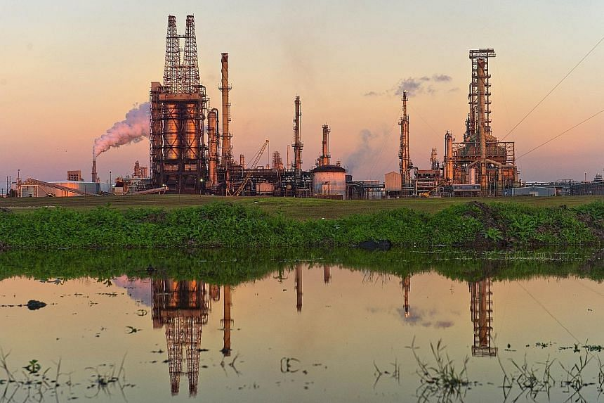 An oil refinery in Corpus Christi, Texas. In the United States, crude stockpiles are forecast to drop for a fourth week, a Bloomberg survey showed, ahead of the release of government data today.