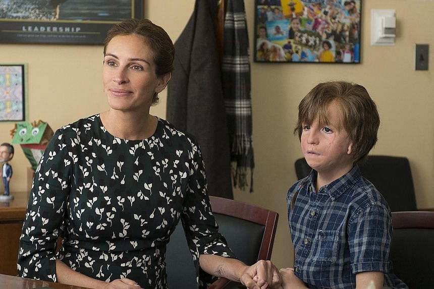 Julia Roberts stars with young actor Jacob Tremblay (wearing heavy prosthetics) in Wonder, which is based on the best-selling book of the same name.
