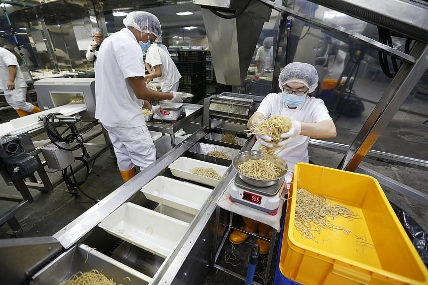 Wholemeal noodles being weighed at Leong Guan Food Manufacturer's factory before being packaged.