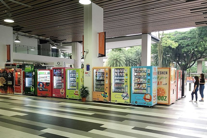 Clockwise from above: Singapore Poly's vending machine cluster offers products like cosmetics and magazines. Students Jermain Hong (far left), 20, and Goh Xin Rui, 19, try out a machine offering cosmetics.