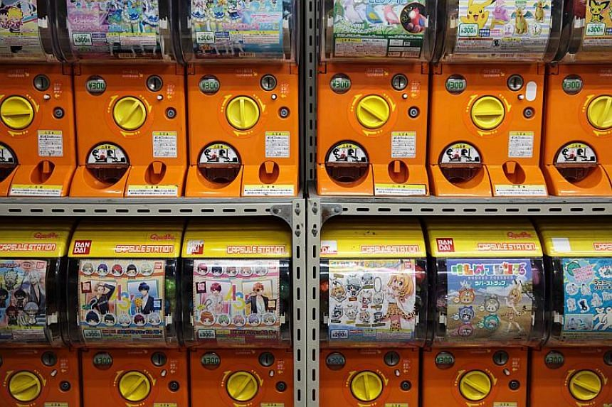 Vending machines containing various series of capsule toys at a store in Tokyo's Akihabara district.