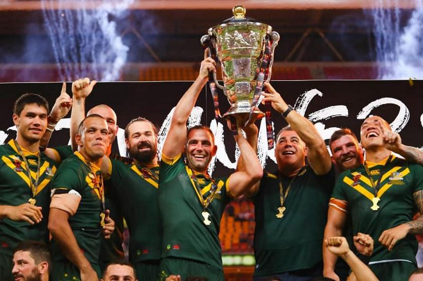 Australian team members celebrate their victory in the Rugby League World Cup men's final match between Australia and England in Brisbane on Dec 2, 2017.