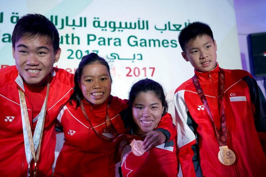 (From left) para-swimmer Wong Zhi Wei (3 golds, 2 silvers), para-swimmer Danielle Moi (2 silvers 1 bronze), Games chef de mission Yip Pin Xiu and para-swimmer Colin Soon (2 bronzes).