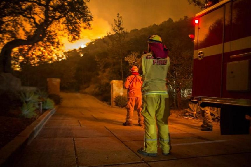 The Thomas Fire approaching homes in Montecito, California, on Dec 12, 2017.
