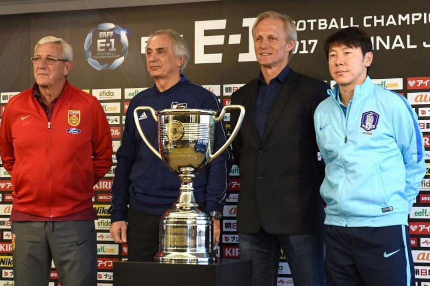 Men's football national team head coaches, Marcello Lippi of China (left), Vahid Halihodzic of Japan (second left), Jorn Andersen of North Korea (third left), and Shin Taeyong of South Korea (right) pose after their joint press conference for the upc