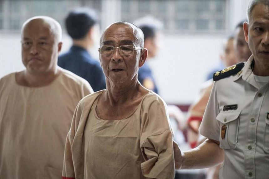 Laota Seanlee being escorted into the Criminal Court in Bangkok on Dec 13, 2017.