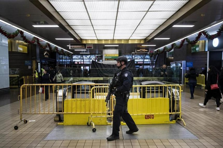 A member of the New York City Police Department standing guard inside the New York Port Authority Bus Terminal after it reopened following an explosion.