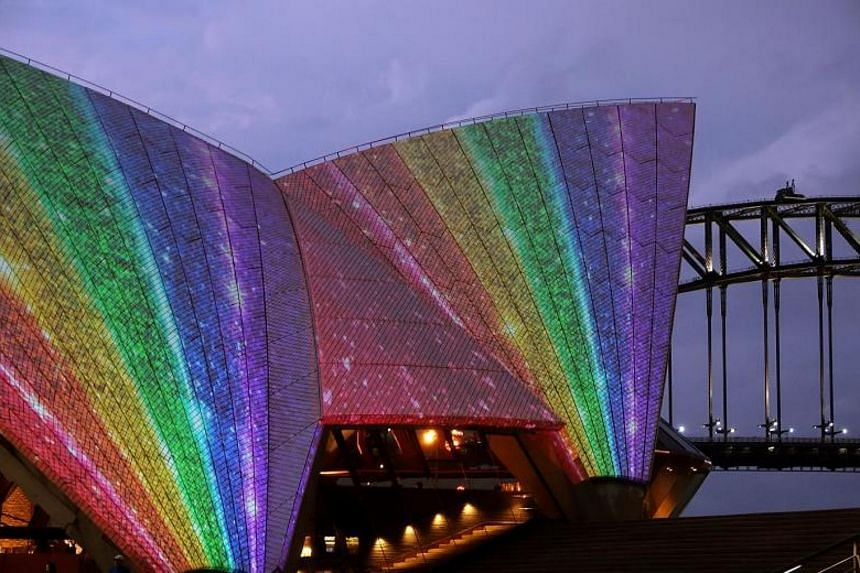 Sydney Opera House lights up to celebrate the passing of the same-sex marriage laws on Dec 8, 2017.