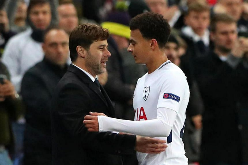 Tottenham's Dele Alli with manager Mauricio Pochettino as he is substituted on Dec 6, 2017.