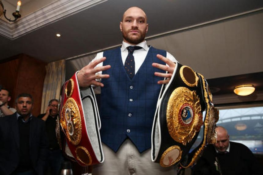 Tyson Fury poses with his belts at The Whites Hotel, Macron Stadium, Bolton on Nov 30, 2015.