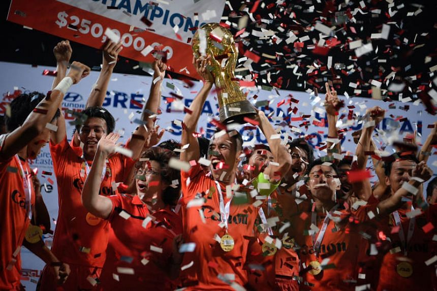 Albirex Niigata FC celebrate after being presented with the S.League winner's trophy after their match with Geylang International FC on Nov 17, 2017.