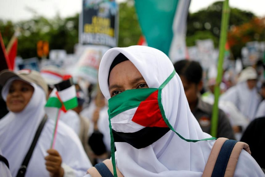 Protesters hold a rally outside the US embassy in Jakarta, Indonesia, to condemn the US decision to recognise Jerusalem as Israel's capital, on Dec 10, 2017.