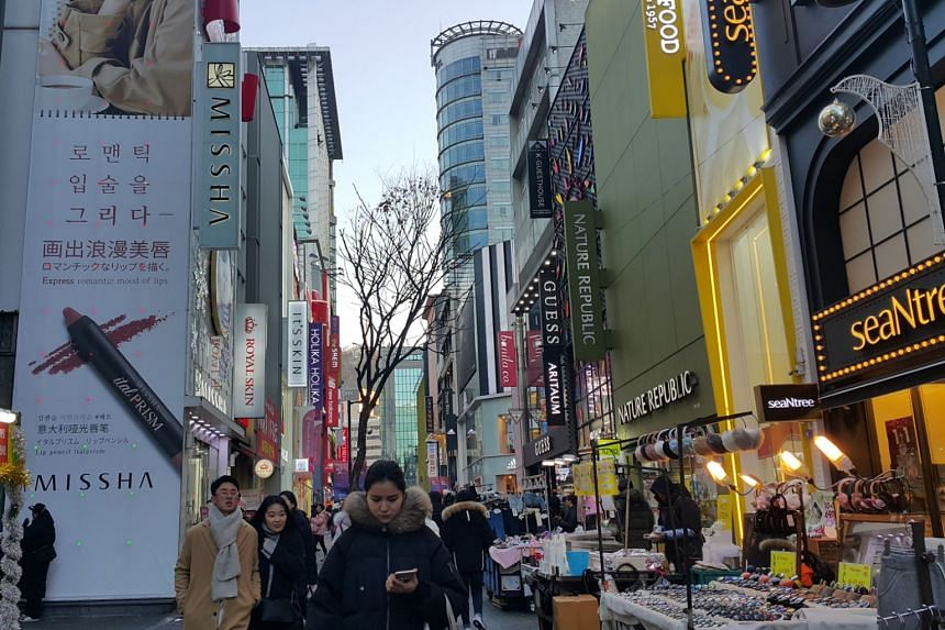 The usually bustling shopping street of Myeongdong in Seoul was not as crowded on Dec 12, 2017 when temperatures hovered around -6 degrees in the afternoon. Only a handful of Chinese tourists were spotted by The Straits Times.