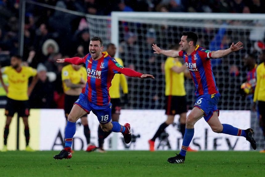 Crystal Palace's James McArthur celebrates after scoring their second goal with Scott Dann.