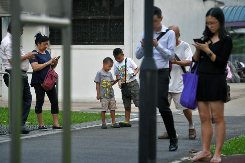 People playing Pokemon Go at a park in Toa Payoh Lorong 1 on Dec 13, 2016.