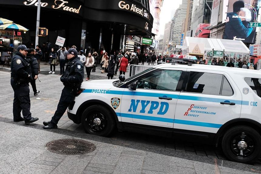 New York City police stand on a corner in Times Square a day after a man prematurely detonated a suicide bomb in nearby Port Authority Bus Terminal.