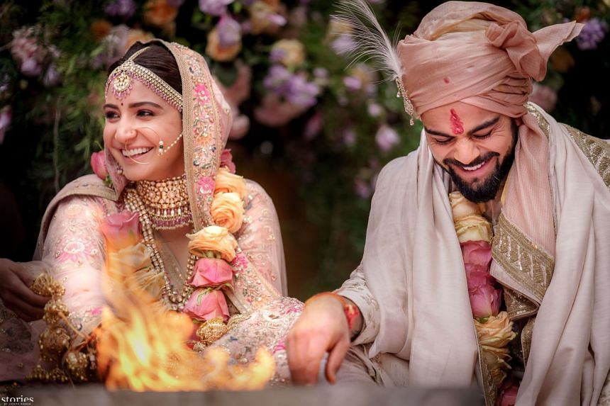 This handout picture by Yash Raj Films shows Indian cricketer Virat Kohli and Bollywood actress Anushka Sharma performing their wedding ceremony in Buonconvento near Siena in Italy on Monday.