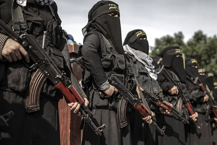 Female Palestinian militants attending a protest in Gaza City on Monday. World leaders have warned that Mr Trump's decision to recognise Jerusalem as the capital of Israel could embolden extremists and hardliners.