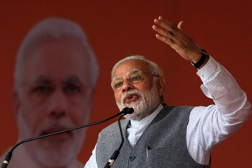 Indian Prime Minister Narendra Modi speaking at an election campaign rally in Sanand, India.
