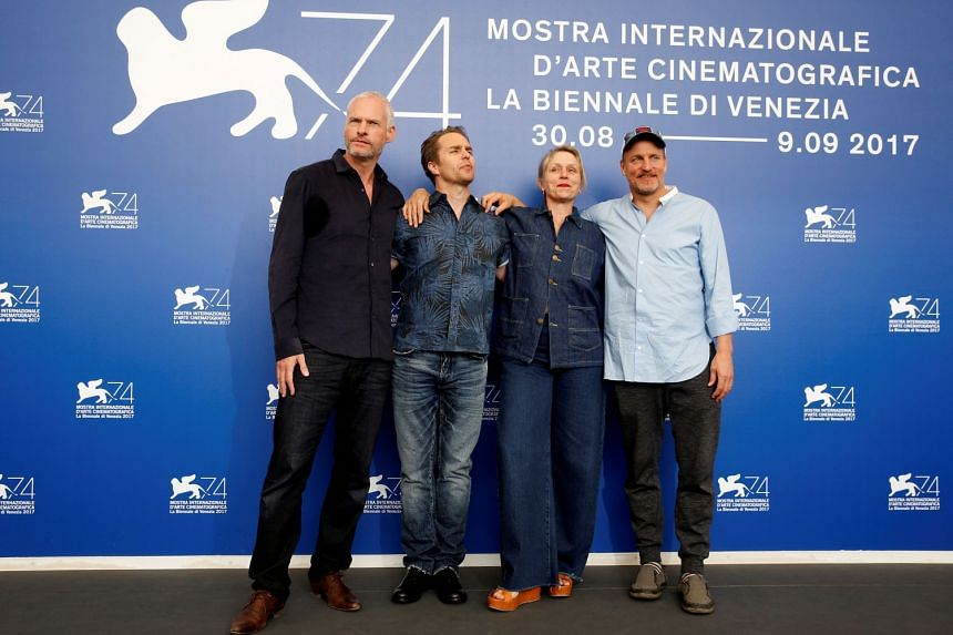 Director Martin McDonagh, actors Sam Rockwell, Frances McDormand and Woody Harrelson pose during a photocall for the movie Three Billboards Outside Ebbing, Missouri at the 74th Venice Film Festival.